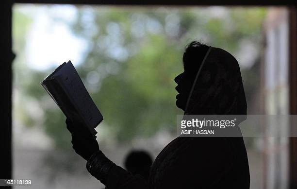 A Pakistani Christian woman attends an Easter Mass at a church in Karachi on March 31 2013 Pakistan is overwhelmingly Muslim and at around two...