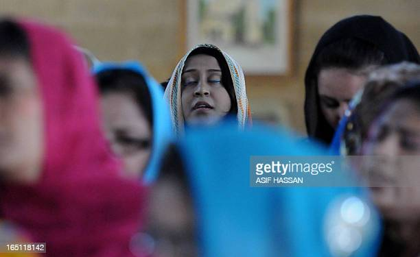 Pakistani Christian women attend an Easter Mass at a church in Karachi on March 31, 2013. Pakistan is overwhelmingly Muslim and at around two percent...