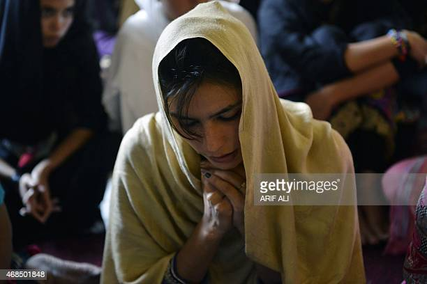 Pakistani Christian worshipers pray during Mass to mark Good Friday at St Anthony Church in Lahore on April 3 2015 Christians around the world are...