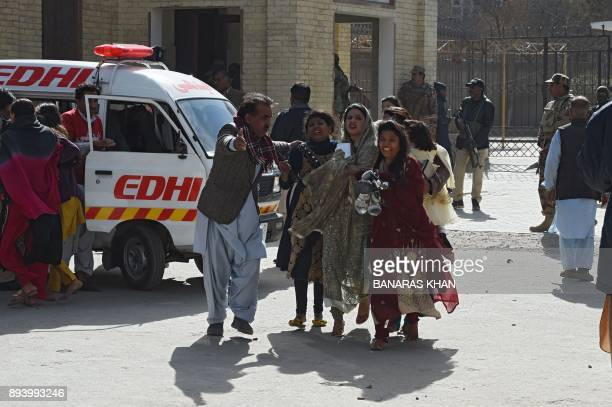 Pakistani Christians are evacuated by security personnel from a Methodist church after a suicide bomber attack during a Sunday service in Quetta on...