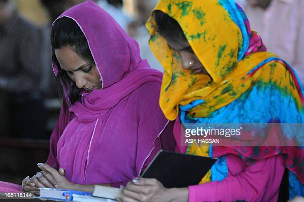 Pakistani Christians attend an Easter Mass at a church in Karachi on March 31, 2013. Pakistan is overwhelmingly Muslim and at around two percent of...