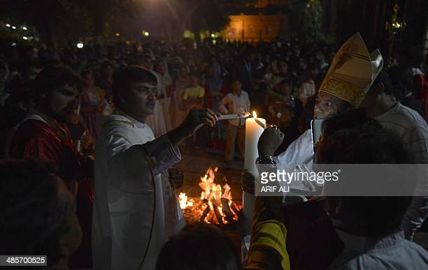 Pakistani Christians attend Easter vigil mass at the Sacred Heart Church in Lahore on April 20 2014 Pope Francis called on Catholics to bring the...
