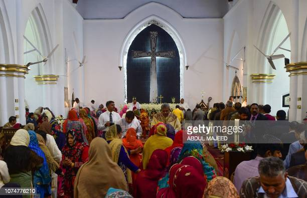 Pakistani Christians attend the Christmas Day service at a church in Peshawar on December 25 2018