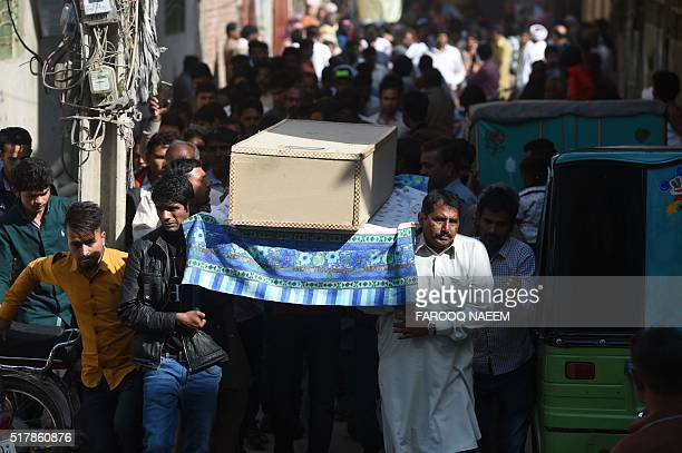 Pakistani Christians carry a coffin of suicide blast victim during a funeral ceremony in Lahore on March 28 2016 The worst fears of Pakistan's...