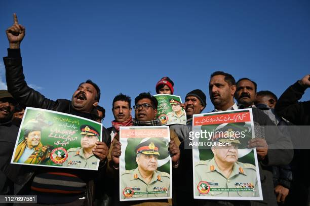 Pakistani Christians carry posters featuring images of Pakistani Army Chief General Qamar Javed Bajwa as they chant slogans against India in...
