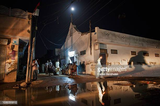 Pakistani Christians gather outside of the damaged United Presbyterian Church on July 23 2010 in the Christian neighbourhood of Daoodnagar Faisalabad...