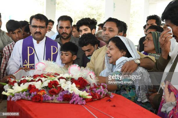 Pakistani Christians mourn over the coffin of a community member who was killed on April 15 in an attack by gunmen during a funeral in Quetta on...