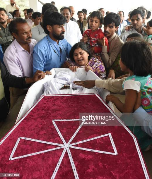 Pakistani Christians mourn over the coffin of a victim a day after an attack by gunmen during a his funeral in Quetta on April 3 2018 Four Christians...