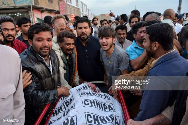 Pakistani Christians mourn the death of relatives who were killed in a driveby shooting outside a church at a hospital in Quetta on April 15 2018 Two...