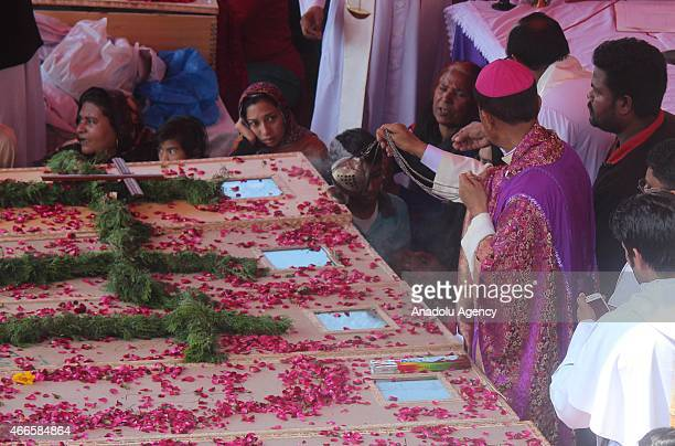 Pakistani Christians offer funeral prayer for the suicide blast victims in Lahore on March 17 2015 Twin blasts rocked the Roman Catholic Church and...