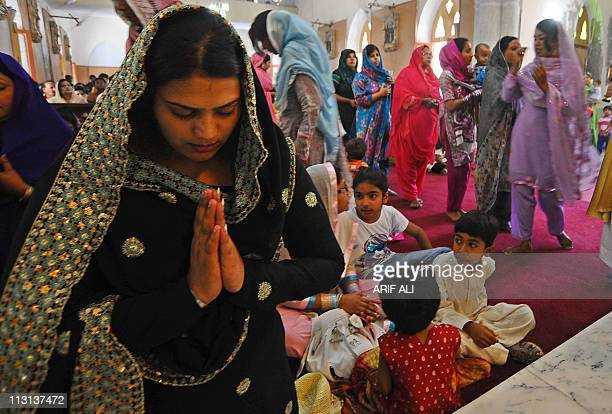 Pakistani Christians pray during an Easter Sunday Mass at a church in Lahore on April 24 2011 hristian believers around the world mark the Holy Week...