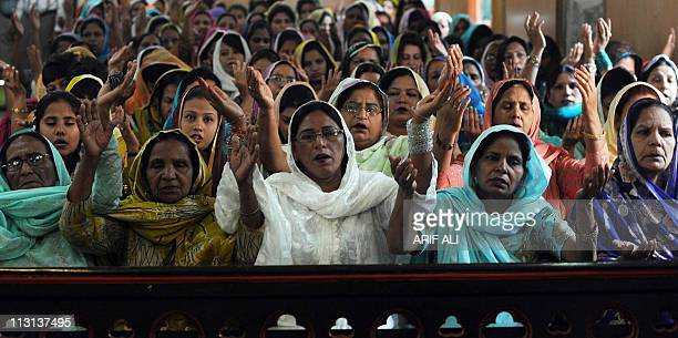Pakistani Christians pray during an Easter Sunday Mass at a church in Lahore on April 24 2011 Christian believers around the world mark the Holy Week...