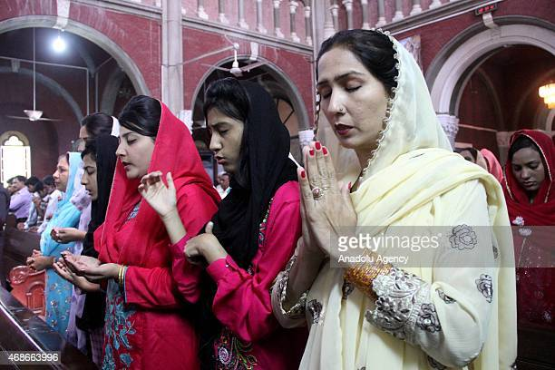 Pakistani Christians pray during Easter service at Saint Antony Church in Lahore Pakistan on April 052015 Christians across the world are celebrating...