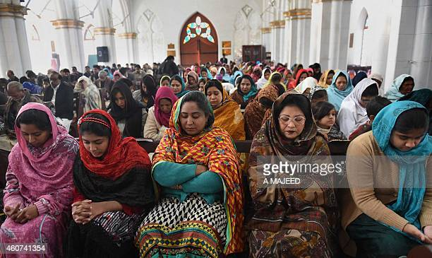 Pakistani Christians pray for the victims of the Peshawar school massacre at St John's Cathedral in Peshawar on December 21 2014 Hundreds of...
