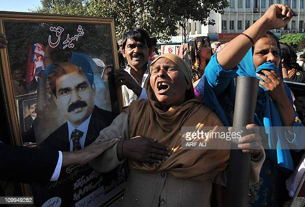 Pakistani Christians shout slogans as they protest against the killing of slain Pakistani minister for minorities Shahbaz Bhatti in Lahore on March...