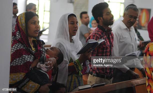 Pakistani Christians sing psalms as they attend special prayers for the victims of an army helicopter which was crashed in the northern mountainous...