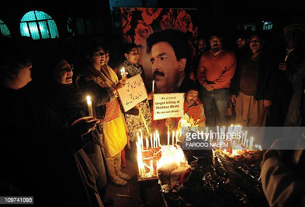 Pakistani civil rights activists gather during a ceremony on the site of the attack on slain Pakistani minority affairs minister Shahbaz Bhatti in...