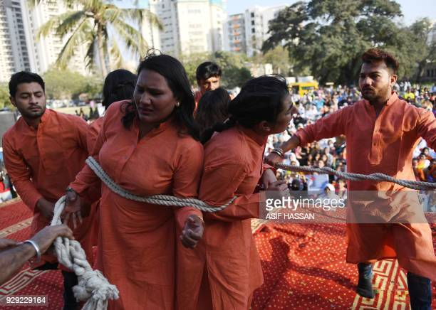 Pakistani civil society activists act a dram during a rally to mark International Women's Day in Karachi on March 8 2018 / AFP PHOTO / ASIF HASSAN