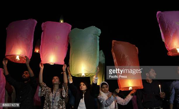 Pakistani civil society activists and Media foundation workers release lanterns in the sky as they pay tribute to victims of Army Public School...
