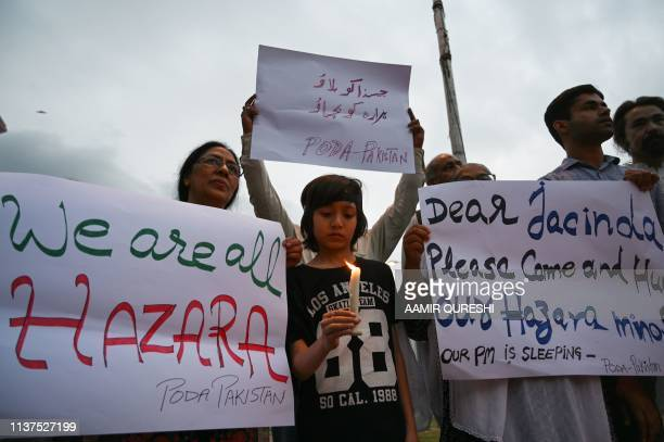 Pakistani civil society activists attend a candle light vigil as they pay tribute to the Shia Hazara ethnic minority members who were killed on April...