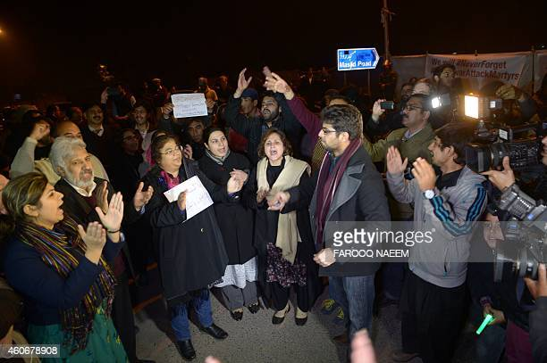 Pakistani civil society activists demonstrate in support of the Peshawar school massacre victims in front of the radical Red Mosque after its...