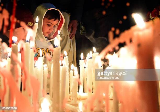 Pakistani civil society activists light candles in Quetta on December 16 on the first anniversary of attack on Army Public School Peshawar Pakistan's...