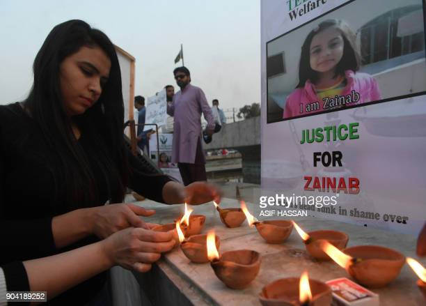 Pakistani civil society activists light oil lamps during a vigil held in tribute to a child who was raped and murdered in Karachi on January 12 2018...