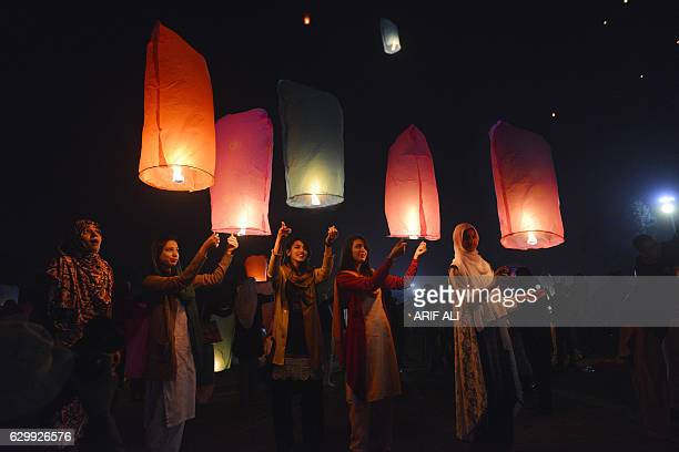 TOPSHOT Pakistani civil society activists release lanterns into the sky in Lahore on December 15 as they pay tribute to victims on the second...