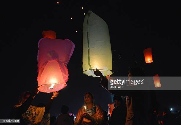 Pakistani civil society activists release lanterns into the sky in Lahore on December 15 as they pay tribute to victims on the second anniversary of...