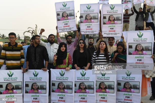 Pakistani civil society activists take part in a protest after a child was raped and murdered in Karachi on January 12 2018 At least two people were...