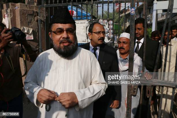 Pakistani cleric Mufti Abdul Qavi comes out from court after the hearing in the murder of social media star Qandeel Baloch in Multan on October 18...