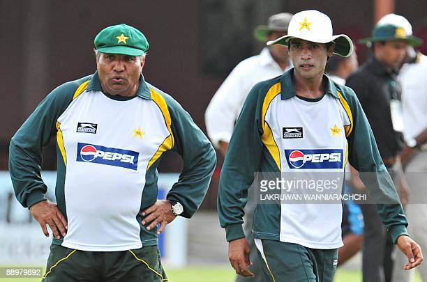 Pakistani Coach Intikhab Alam and cricketer Mohammad Aamer look on during a practice session at the P Saravanamuttu Stadium in Colombo on July 11...