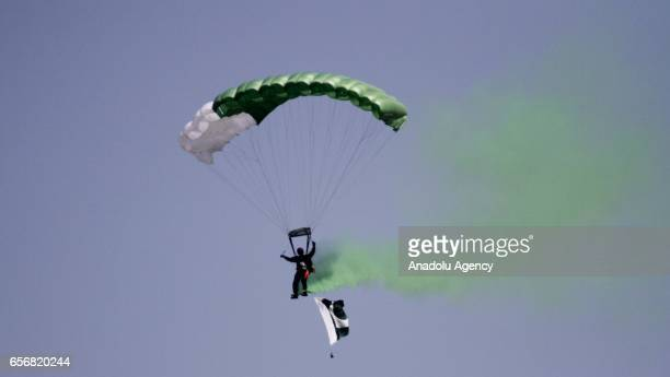 Pakistani commando from Special Services Group takes part in a parachute jump during a military parade to mark Pakistan's National Day in Islamabad...