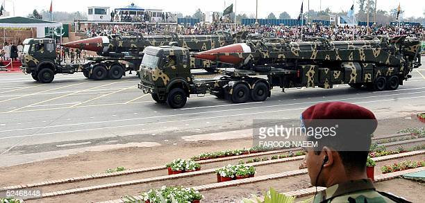 Pakistani commando looks on as Ghauri intermediate-range missiles capable of carrying nuclear warhead are transported on launchers during the...