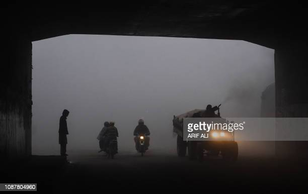 TOPSHOT Pakistani commuters drive their vehicles in a tunnel amid heavy fog and smog conditions in Lahore on January 24 2019 Smog levels spike during...