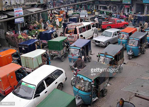 Pakistani commuters ride past a market in Mingora a town of Swat valley on February 22 2009 Militants who led a deadly campaign to enforce Islamic...