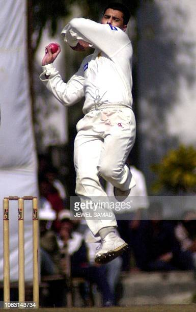 Pakistani cricket captain and pace-bowler Waqar Younis delivers a ball to Bangladeshi batsman Mehrab Hussain during the second day of a three-day...