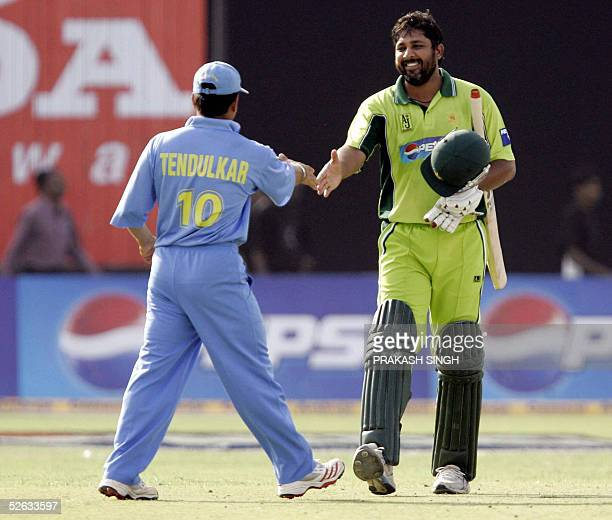 Pakistani cricket captain Inzamam UlHaq smiles as he shakes hands with Indian opponent Sachin Tendulkar at the conclusion of the fifth one day...