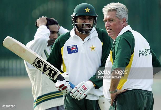 Pakistani cricket captain InzamamulHaq speaks with team coach Bob Woolmer during a net practice session in Mohali 06 March 2005 Pakistan are...