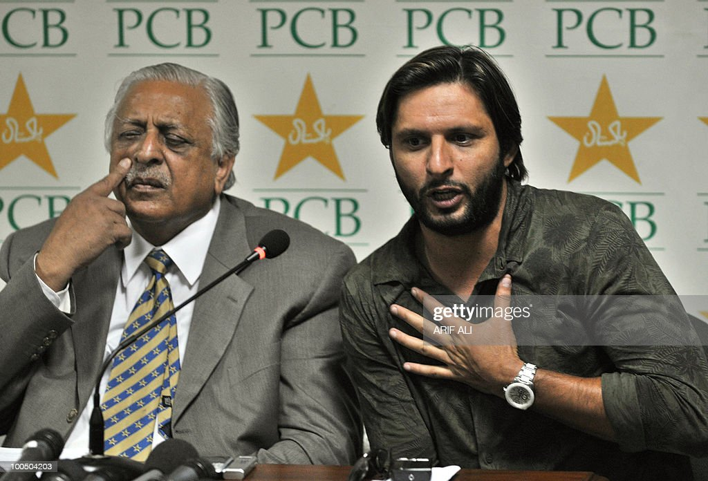 Pakistani cricket captain Shahid Afridi (R) addresses a press conference along with Pakistan Cricket Board (PCB) chairman Ijaz Butt in Lahore on May 25, 2010. Dashing all-rounder Shahid Afridi was named Pakistan skipper for next month's Asia Cup and the following tour of England, uniting the team under one captain for all three formats of the game. AFP PHOTO/Arif ALI