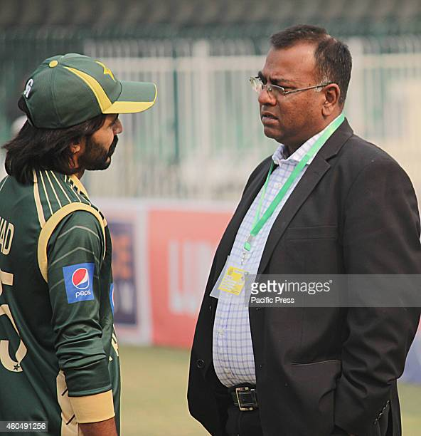 Pakistani cricket coach Basit Ali conversation with team captainn Fawad Alam during the 1st one day match at the Qaddafi Stadium Lahore Pakistan A...