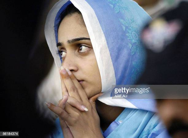 Pakistani cricket fan prays during the last minutes of the fifth and last day of the first Test match in Multan Cricket Stadium 16 November 2005...