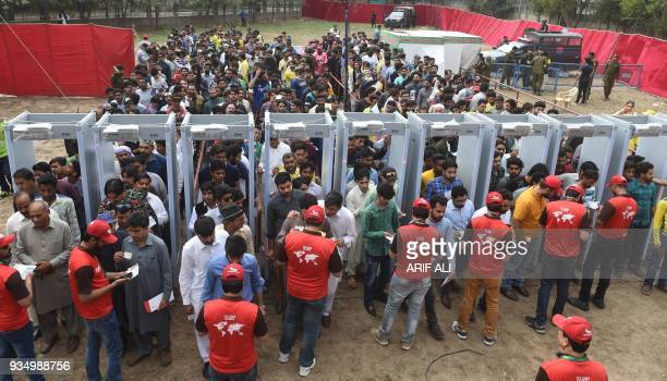 Pakistani cricket fans arrive and are searched ahead of the PSL T20 cricket match between Quetta Gladiators and Peshawar Zalmi teams at the Gaddafi...