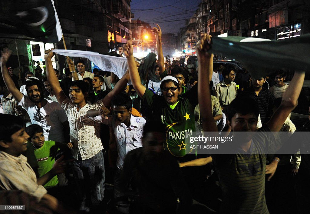 Pakistani Cricket Fans Celebrate On A Street In Karachi On March 23 2011 After