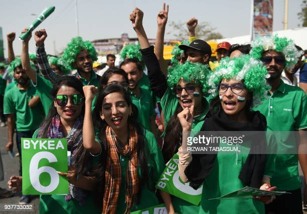 Pakistani cricket fans chant outside the the National Cricket Stadium in Karachi on March 25 for the Pakistan Super League final between Peshawar...