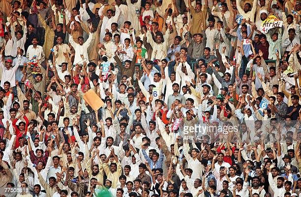 Pakistani cricket fans cheer their team during the fourth daynight international match between Pakistan and South Africa at The Multan Cricket...