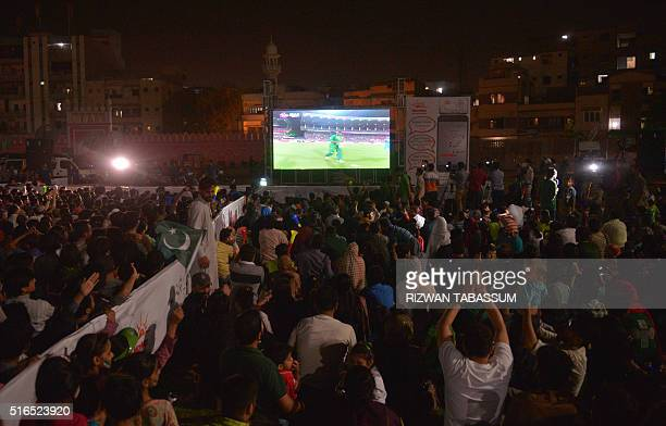 Pakistani Cricket Fans Gather Around Screen On A Street In Karachi On March 19 As They
