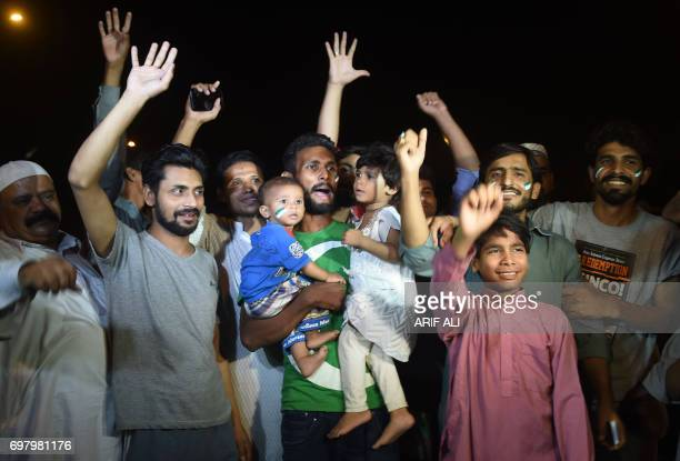Pakistani cricket fans gather outside the Allama Iqbal International airport to welcome their national team's arrival from London in Lahore on June...
