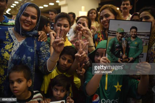 Pakistani cricket fans gather outside the Karachi International airport to welcome their national team's arrival from London in Karachi on June 20...