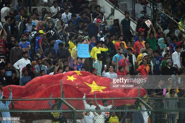 Pakistani cricket fans waves Chinese flag during the Pakistan Super League final match between Peshawar Zalmi and Islamabad United at the National...
